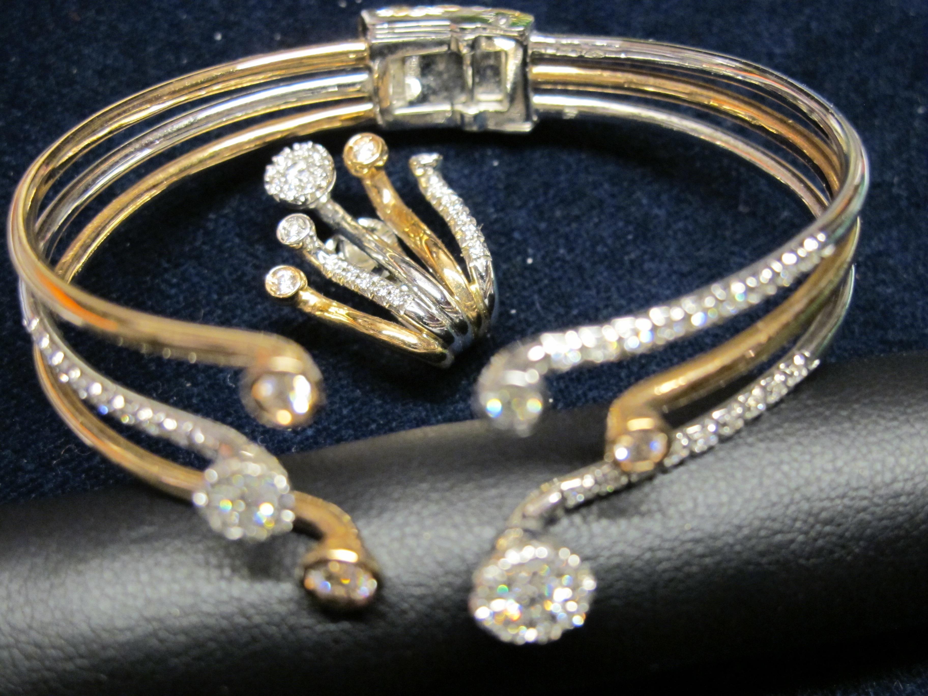 bracciale  rigido con spilla oro giallo e diamanti